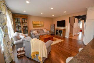 """Photo 3: 10004 117 Avenue in Fort St. John: Fort St. John - City NW 1/2 Duplex for sale in """"GARRISON LANDING"""" (Fort St. John (Zone 60))  : MLS®# R2395765"""