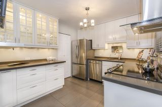"Photo 1: 1237 PLATEAU Drive in North Vancouver: Pemberton Heights Condo for sale in ""Plateau Village"" : MLS®# R2224037"
