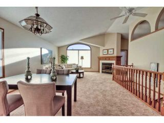 Photo 3: 723 WOODBINE Boulevard SW in CALGARY: Woodbine Residential Attached for sale (Calgary)  : MLS®# C3584095