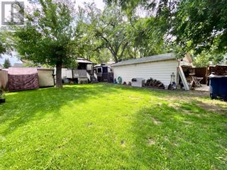 Photo 5: 415 3A Street W in Brooks: House for sale : MLS®# A1129371