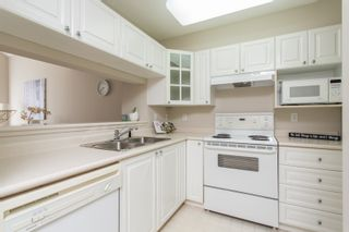 """Photo 8: 406 1190 EASTWOOD Street in Coquitlam: North Coquitlam Condo for sale in """"LAKESIDE TERRACE"""" : MLS®# R2491476"""
