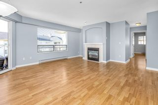 """Photo 5: 310 20120 56 Avenue in Langley: Langley City Condo for sale in """"Blackberry Lane"""" : MLS®# R2564037"""
