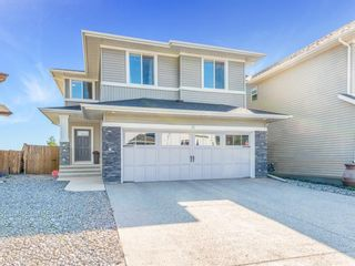 Photo 1: 84 Sage Bank Crescent NW in Calgary: Sage Hill Detached for sale : MLS®# A1027178