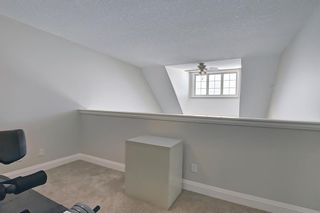 Photo 28: 2407 15 SUNSET Square: Cochrane Apartment for sale : MLS®# A1072593