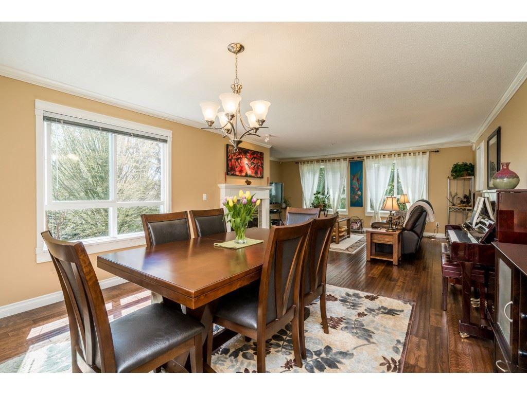"Main Photo: 228 13880 70 Avenue in Surrey: East Newton Condo for sale in ""Chelsea Gardens"" : MLS®# R2563447"
