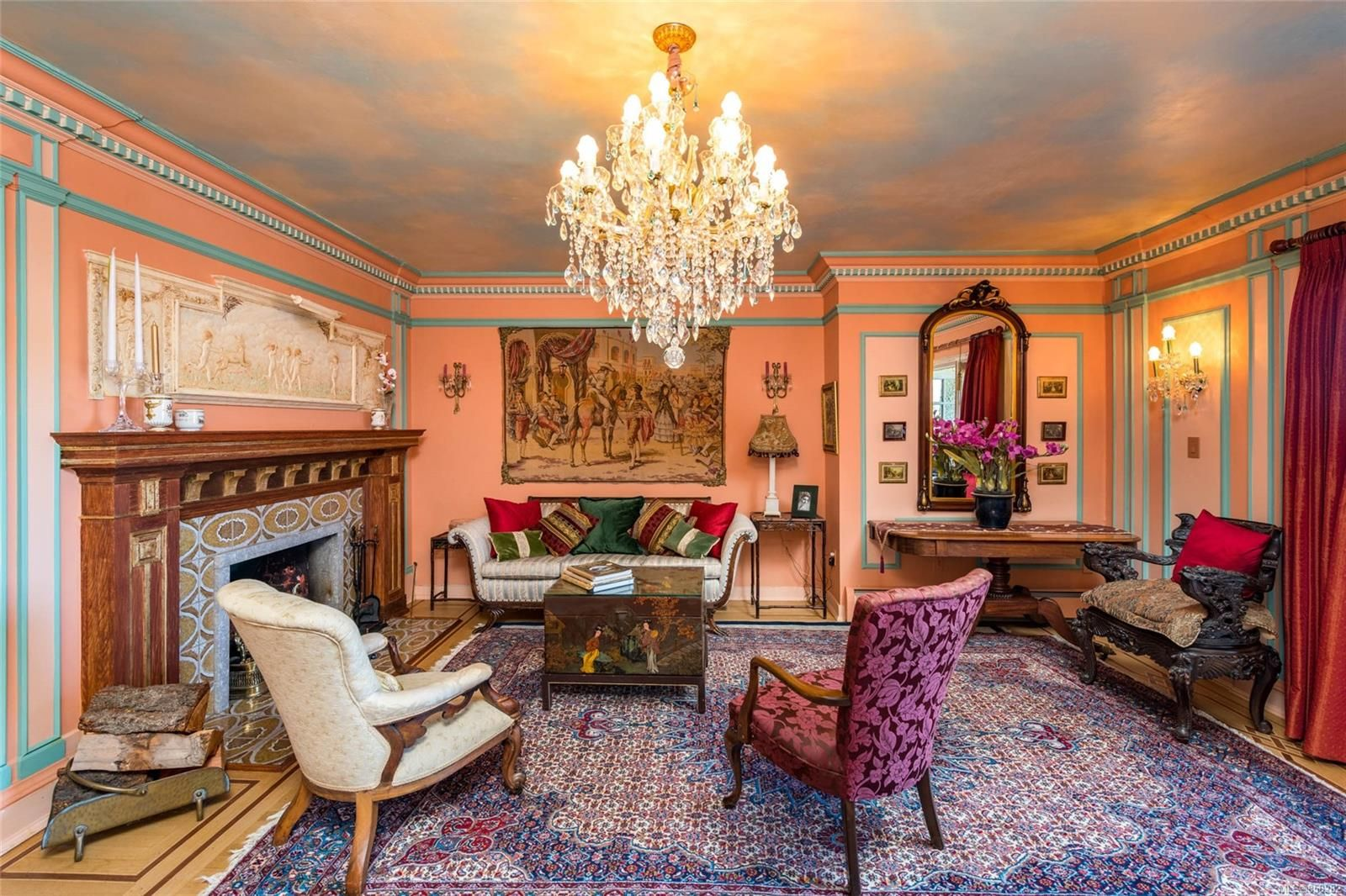 The expansive living room was once the original music room in the home when it was built in 1912.The main chandelier in the living room is Murano from Venice Italy, all hand cut crystal.