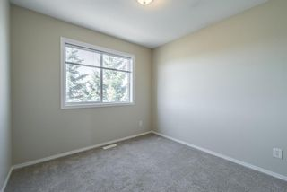 Photo 24: 404 720 Willowbrook Road NW: Airdrie Row/Townhouse for sale : MLS®# A1098346