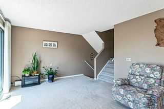 Photo 5: 1413 Ranchlands Road NW in Calgary: Ranchlands Row/Townhouse for sale : MLS®# A1133329