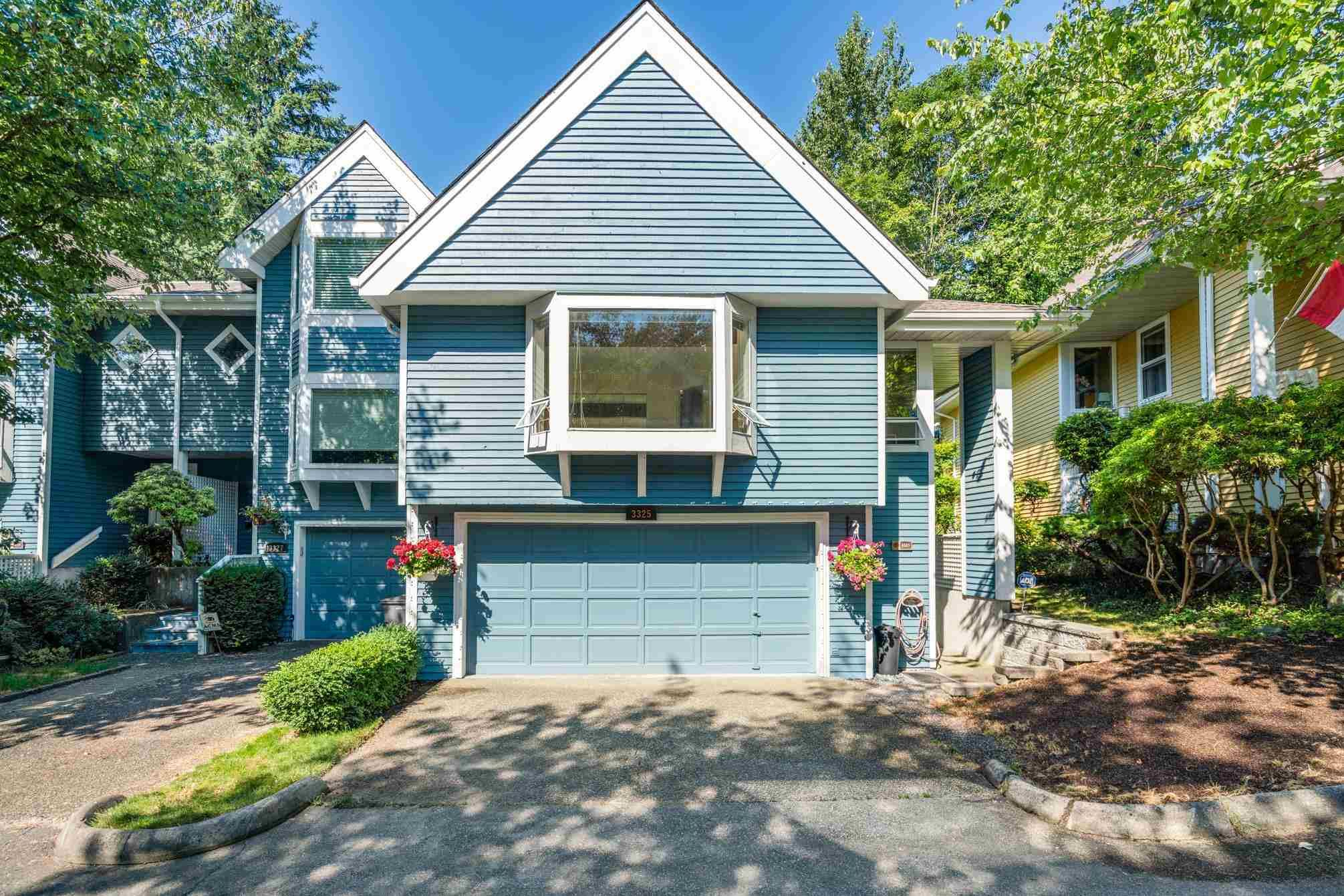 """Main Photo: 3325 FLAGSTAFF Place in Vancouver: Champlain Heights Townhouse for sale in """"COMPASS POINT"""" (Vancouver East)  : MLS®# R2597244"""