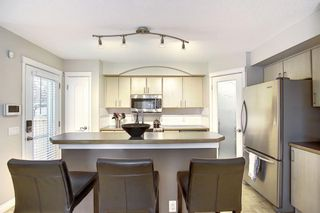 Photo 6: 168 Tuscany Springs Way NW in Calgary: Tuscany Detached for sale : MLS®# A1095402