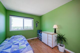 Photo 34: 332 Queenston Heights SE in Calgary: Queensland Row/Townhouse for sale : MLS®# A1114442