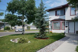 Photo 1: Affordable half duplex in Calgary, Alberta
