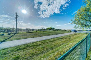 Photo 47: 4 136 Bow Ridge Drive: Cochrane Row/Townhouse for sale : MLS®# A1116097