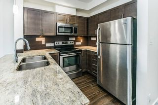 """Photo 8: 215 13468 KING GEORGE Boulevard in Surrey: Whalley Condo for sale in """"Brookland"""" (North Surrey)  : MLS®# R2624857"""