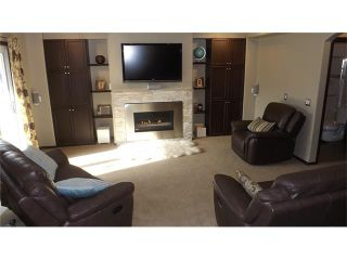 Photo 19: 155 SUNSET Close: Cochrane House for sale : MLS®# C4037159