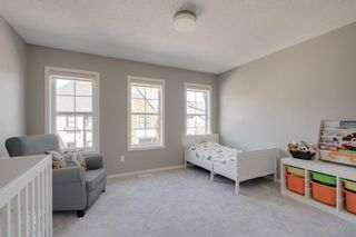 Photo 18: 111 Ascot Point SW in Calgary: Aspen Woods Row/Townhouse for sale : MLS®# A1144877