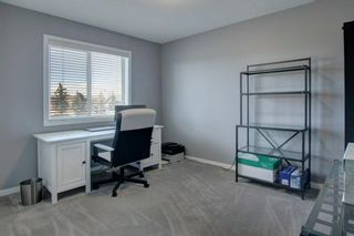 Photo 23: 192 Cougartown Close SW in Calgary: Cougar Ridge Detached for sale : MLS®# A1106763