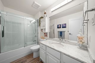 """Photo 19: 510 4001 MT SEYMOUR Parkway in North Vancouver: Roche Point Townhouse for sale in """"THE MAPLES"""" : MLS®# R2602101"""