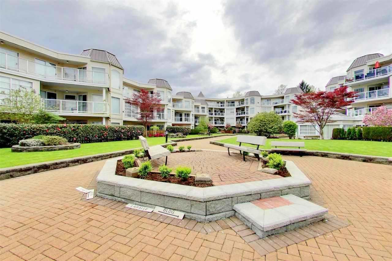 "Main Photo: 209 1220 LASALLE Place in Coquitlam: Canyon Springs Condo for sale in ""MOUNTAIN SIDE"" : MLS®# R2162103"