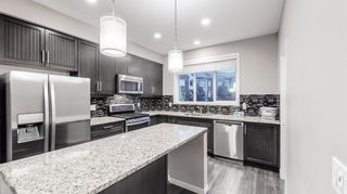 Main Photo: 154 Copperpond Villas SE in Calgary: Copperfield Row/Townhouse for sale : MLS®# A1147396
