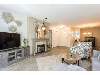 """Photo 6: 102 2733 ATLIN Place in Coquitlam: Coquitlam East Condo for sale in """"ATLIN COURT"""" : MLS®# R2475795"""