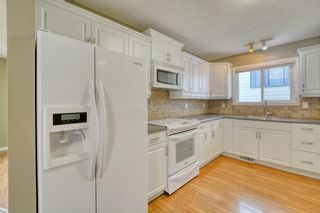 Photo 12: 128 Shawmeadows Crescent SW in Calgary: Shawnessy Detached for sale : MLS®# A1129077