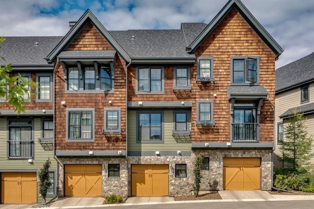 Main Photo: 235 ASCOT Circle SW in Calgary: Aspen Woods Row/Townhouse for sale : MLS®# A1025064