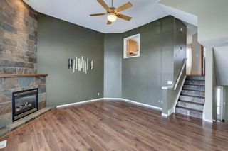 Photo 7: 105 Rocky Ridge Court NW in Calgary: Rocky Ridge Row/Townhouse for sale : MLS®# A1069587