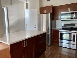 Photo 2: 209 10 Auburn Bay Link SE in Calgary: Auburn Bay Apartment for sale : MLS®# A1147935