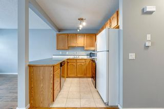 Photo 6: 57 Millview Green SW in Calgary: Millrise Row/Townhouse for sale : MLS®# A1135265