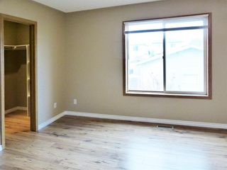 Photo 10: 107 Mt Allan Circle SE in Calgary: McKenzie Lake Detached for sale : MLS®# A1068557