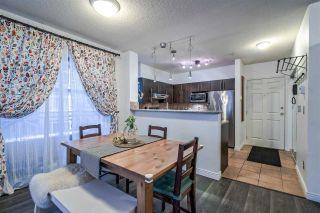 """Photo 4: 312 3625 WINDCREST Drive in North Vancouver: Roche Point Condo for sale in """"Windsong @ Raven Woods"""" : MLS®# R2350917"""