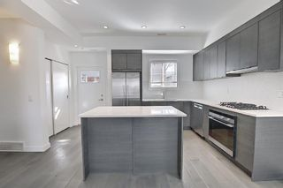 Photo 4: 202 1818 14A Street SW in Calgary: Bankview Row/Townhouse for sale : MLS®# A1115942