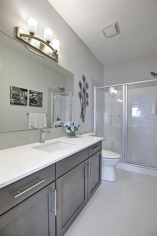 Photo 27: 191 Silverado Plains Park SW in Calgary: Silverado Row/Townhouse for sale : MLS®# A1086865
