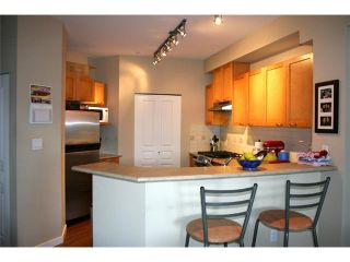 Photo 7: 310 2969 WHISPER Way in Coquitlam: Westwood Plateau Condo for sale : MLS®# V879520