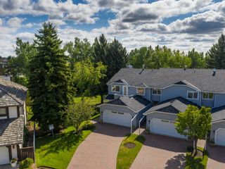 Photo 3: 24 WOOD Crescent SW in Calgary: Woodlands Row/Townhouse for sale : MLS®# A1154480