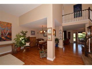 Photo 3: 148 GLENEAGLES Close: Cochrane House for sale : MLS®# C4010996
