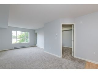 """Photo 8: 209 5465 203 Street in Langley: Langley City Condo for sale in """"Station 54"""" : MLS®# R2394003"""
