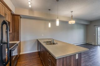 Photo 4: 9308 101 Sunset Drive: Cochrane Apartment for sale : MLS®# A1079009