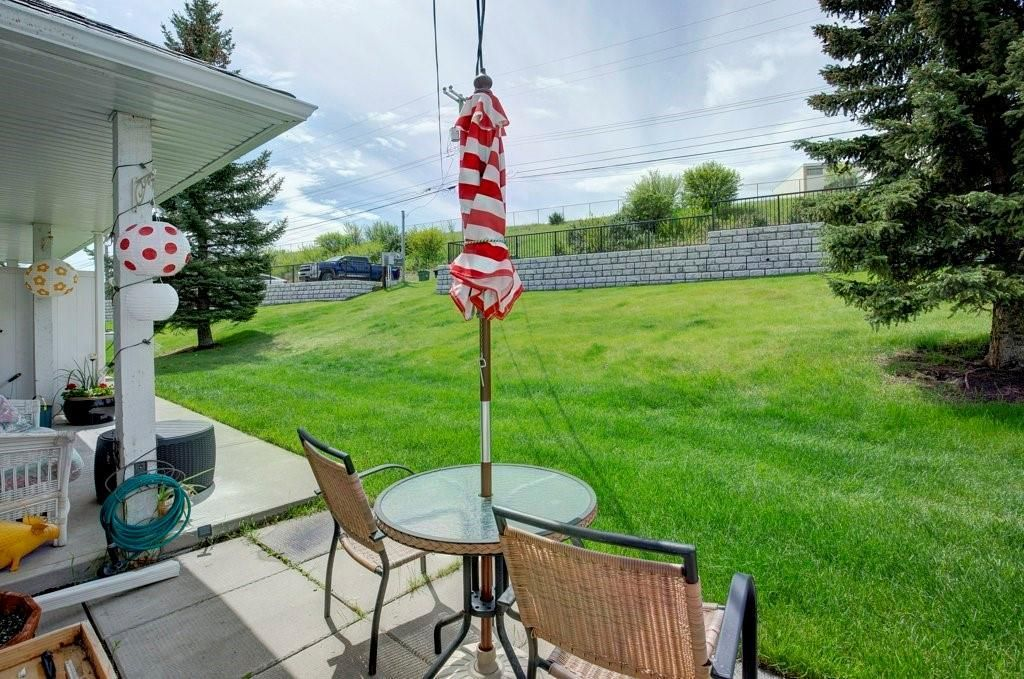 Photo 24: Photos: 615 Merrill Drive NE in Calgary: Winston Heights/Mountview Row/Townhouse for sale : MLS®# C4301720