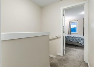 Photo 19: 102 2400 RAVENSWOOD View SE: Airdrie Row/Townhouse for sale : MLS®# A1092501