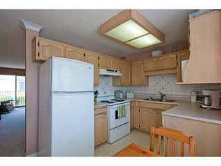"""Photo 7: 6 2420 PITT RIVER Road in Port Coquitlam: Mary Hill Townhouse for sale in """"PARKSIDE ESTATES"""" : MLS®# V1143548"""