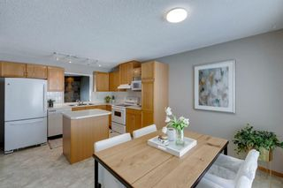 Photo 10: 105 Rocky Ridge Court NW in Calgary: Rocky Ridge Row/Townhouse for sale : MLS®# A1069587