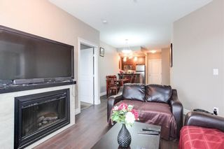 """Photo 1: 310 2343 ATKINS Avenue in Port Coquitlam: Central Pt Coquitlam Condo for sale in """"THE PEARL"""" : MLS®# R2302203"""