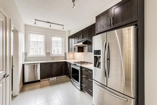 Photo 4: 30 Sherwood Row NW in Calgary: Sherwood Row/Townhouse for sale : MLS®# A1136563