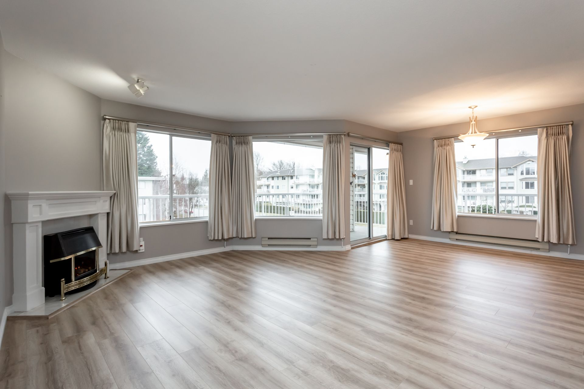 Beautiful and spacious living room with large windows allows light to flood in!
