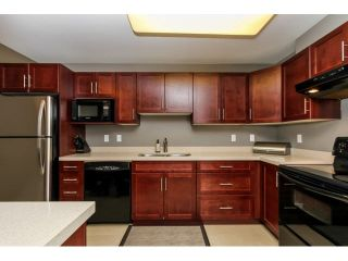 "Photo 4: 110 3075 PRIMROSE Lane in Coquitlam: North Coquitlam Condo for sale in ""LAKESIDE TERRACE"" : MLS®# V1117875"