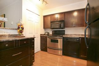 """Photo 6: 102 5294 204 Street in Langley: Langley City Condo for sale in """"""""Waters Edge"""" NWS 1817"""""""" : MLS®# R2169819"""