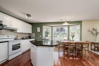 Photo 10: 85 STRATHRIDGE Close SW in Calgary: Strathcona Park Detached for sale : MLS®# A1019965
