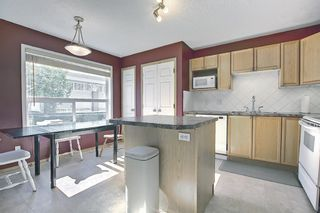 Photo 11: 403 950 Arbour Lake Road NW in Calgary: Arbour Lake Row/Townhouse for sale : MLS®# A1140525